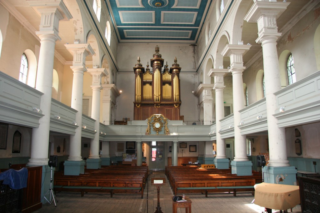 Interior view - Pipe organ and Nave. (Image courtesy Historic England)