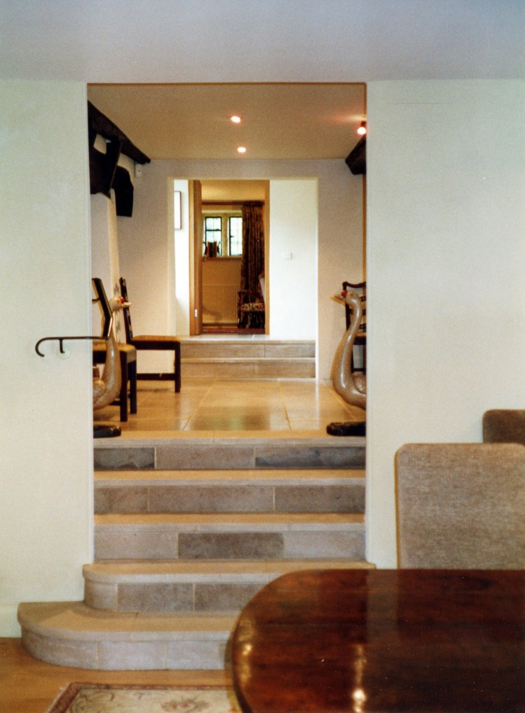 Steps up from new dining room to staircase hall